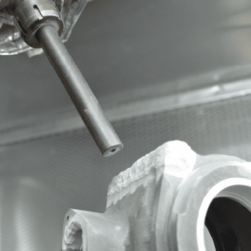 cold spray being applied to metal part