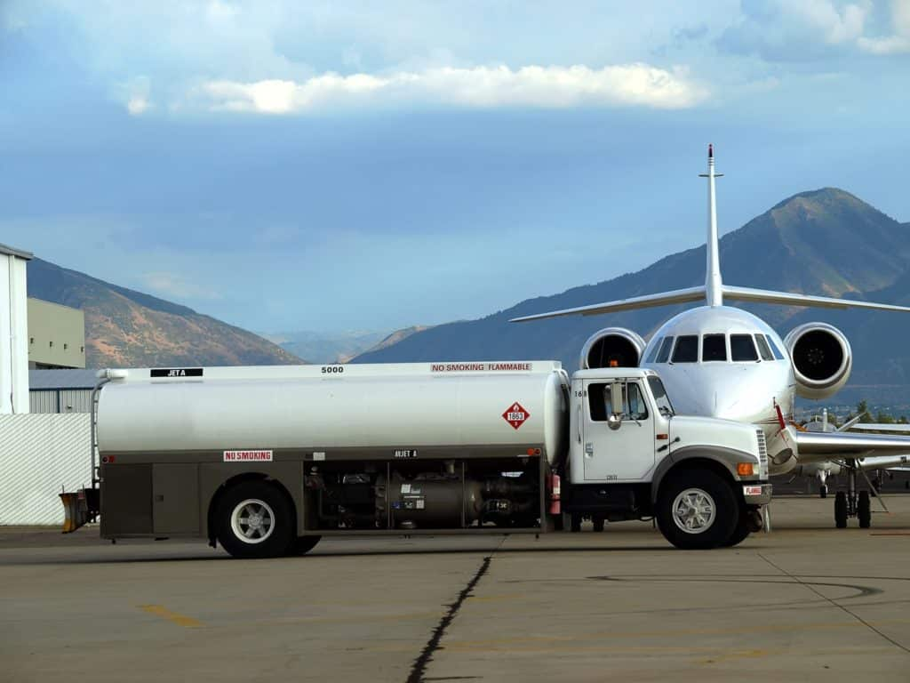 A fuel truck filling up an airplane