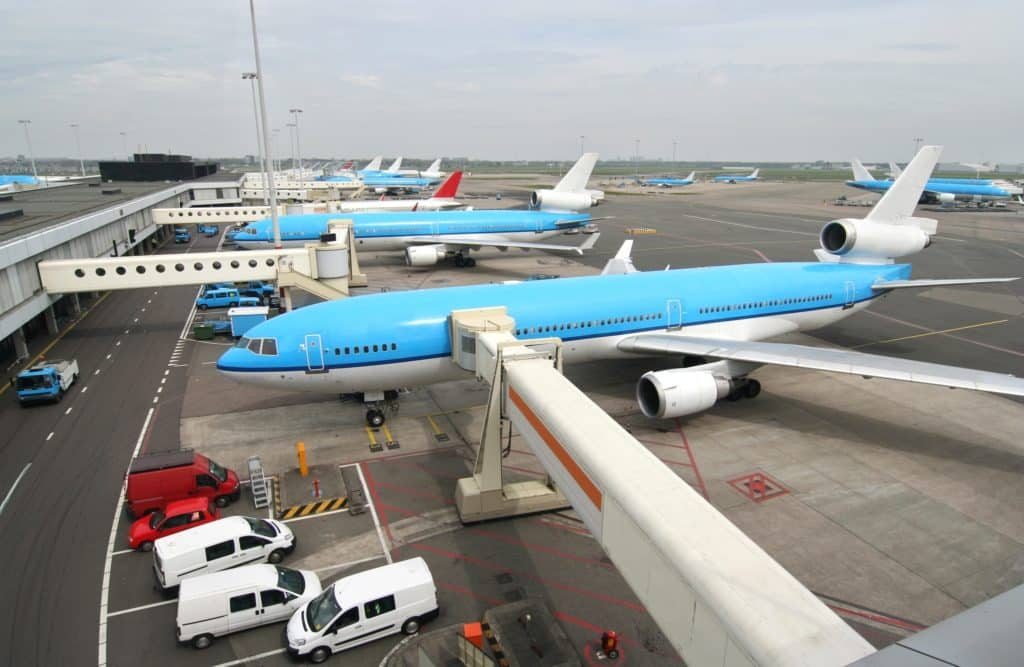 A fleet of blue commercial airplanes