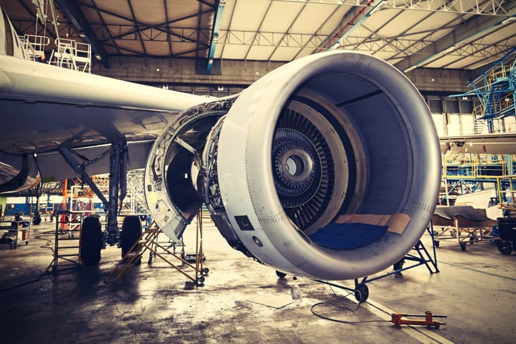 An airplane turbine in a hangar ready to be inspected for aircraft component repair